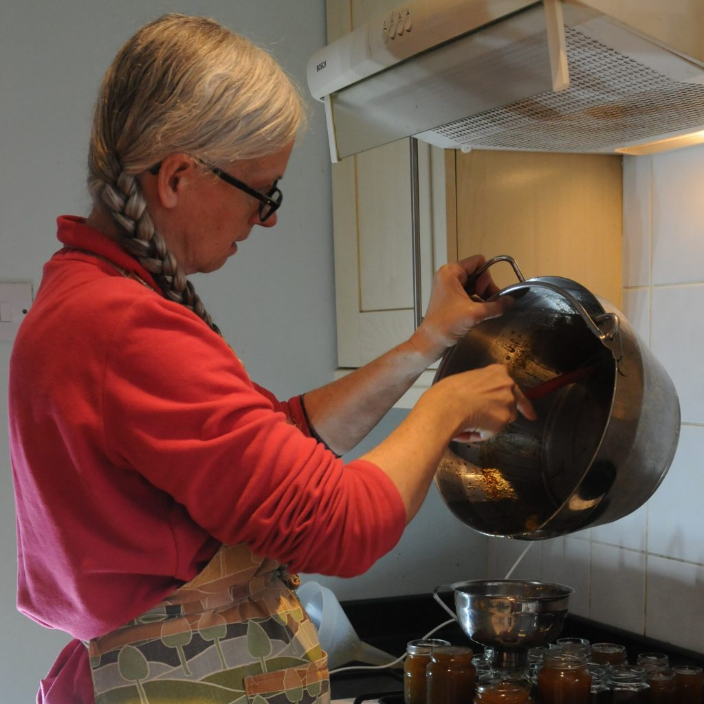 Moira pouring hot jam into jars